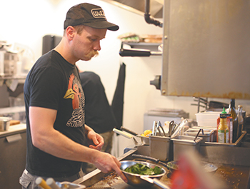 Rockne Roll/News-Register</br>Kyle Christensen is chef at The Diner.