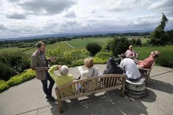Visitors bask in lovely summer weather at Anne Amie Vineyards.   <B>Photo by Marcus Larson</b>